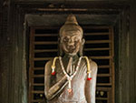 Standing Buddha status inside the main inner spire