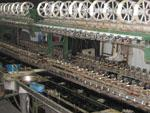 Large machine unwinding the silk threads from silkworm cocoons