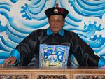 Man wearing traditional clothes of a Chinese judge