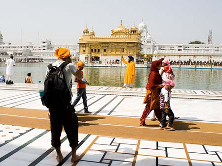Travis taking a photo of a Sikh at the Golden Temple
