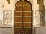 Colourfully decorated wooden door of the Nahargarh For palace