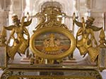Gold leafed throne with painting on Ganesha in the centre