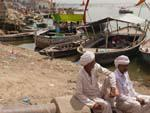Two local men resting with the Ganges in the background
