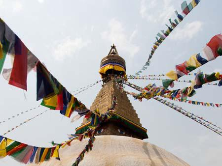 Prayer flags running to the tip of Bodhnath Stupa