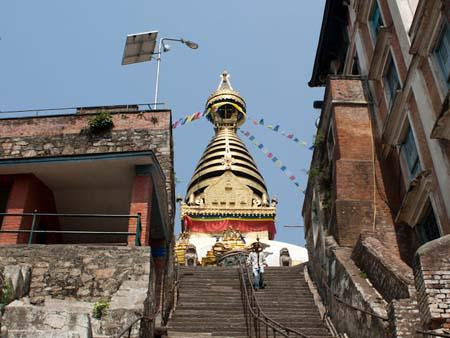 The gold gilding of the stupa seen from the lower stairs