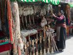A Tibetan lady selling various items